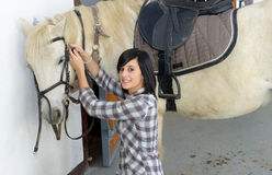 Beautiful young girl and white horse Stock Images