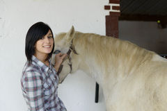 Beautiful young girl and white horse Royalty Free Stock Images