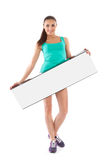 Beautiful young girl with white placard Royalty Free Stock Photography