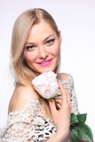 Beautiful young girl with a white rose Stock Images