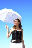 Beautiful young girl with a white umbrella. Very beautiful young girl with a white umbrella Stock Photo