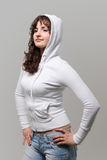 Beautiful young girl in a white woman's jacket Stock Image