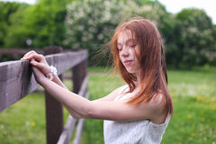 Beautiful young girl in the wind. Young young lady posing and hair ruffled by the wind Stock Image