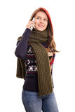 Beautiful young girl in winter clothes talking on a phone Stock Image
