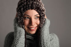 Beautiful young girl in winter wool jumper and hat Royalty Free Stock Photography