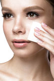 Beautiful young girl with wipes for removing makeup and French manicure. Beauty face. Stock Image