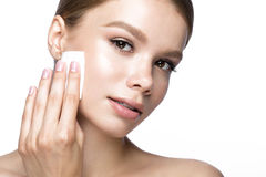 Beautiful young girl with wipes for removing makeup and French manicure. Beauty face. Stock Photos