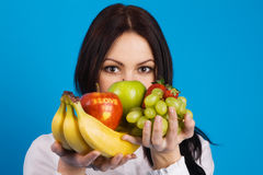 Beautiful Young Girl With A Bunch Of Fruits Royalty Free Stock Photo