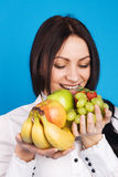 Beautiful Young Girl With A Bunch Of Fruits Stock Images