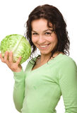 Beautiful Young Girl With Green Cabbage Royalty Free Stock Photos