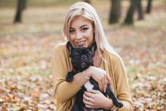 Free Beautiful Young Girl With Her Dog In Autumn Park Royalty Free Stock Images - 123388779
