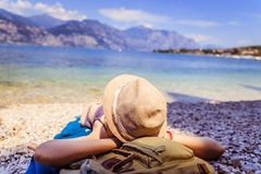 Free Beautiful Young Girl With Straw Hat In Bikini Is Lying On The Pebble Beach And Enjoying The View, Vacation In Italy Stock Image - 148219841