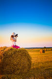 Beautiful Young Girl Woman In Dress Sitting On Haystack Royalty Free Stock Photography
