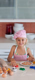 Beautiful young Girl Working in the Kitchen Stock Image