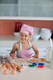 Beautiful young Girl Working in the Kitchen Royalty Free Stock Photo