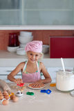 Beautiful young Girl Working in the Kitchen Royalty Free Stock Image
