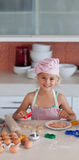 Beautiful young Girl Working in the Kitchen Stock Images