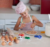 Beautiful young Girl Working in the Kitchen Stock Photo
