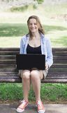 Beautiful young girl  working on a laptop Royalty Free Stock Photo
