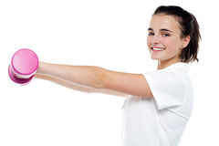 Beautiful young girl working out Royalty Free Stock Photos