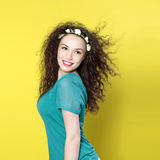 Beautiful young girl on yellow background Royalty Free Stock Photos