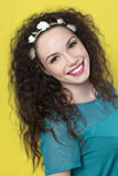 Beautiful young girl on yellow background stock photos