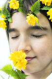 Beautiful young girl with yellow flowers. Stock Image