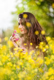 Beautiful young girl among yellow flowers Stock Photos