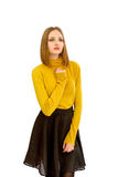 Beautiful young girl in a yellow sweater and a black skirt Royalty Free Stock Photos