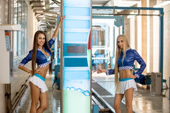 Beautiful young girls advertise car wash Royalty Free Stock Photography