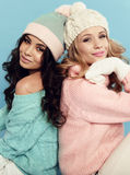 Beautiful young girls with  curly hair wears cozy warm clothes Stock Photo