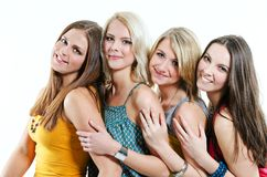 Beautiful young girls. Four beautiful smiling young girls in colorful T-shirts Stock Images
