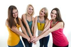 Beautiful young girls. Four beautiful smiling young girls in colorful T-shirts Stock Photography