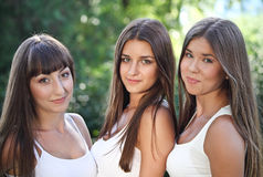 Beautiful young girls in green summer park Stock Photo