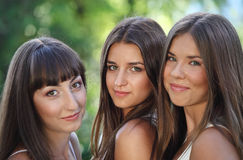 Beautiful young girls in green summer park Royalty Free Stock Photos