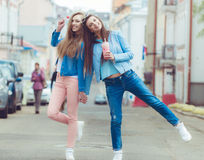 Beautiful young girls hipster girlfriends posing Royalty Free Stock Photography