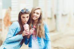Beautiful young girls hipster girlfriends posing Stock Photos