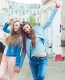 Beautiful young girls hipster girlfriends posing Royalty Free Stock Photo