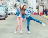 Beautiful young girls hipster girlfriends posing Royalty Free Stock Images