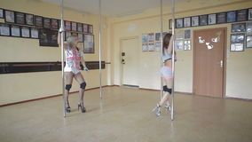 Beautiful young girls Pole dance studio stock footage video stock video footage