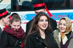 Beautiful young girls portrait on the winter ending Transylvanian traditional carnival. Crowd royalty free stock images