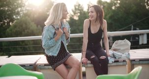 Free Beautiful Young Girls Relaxing On A Rooftop In A City. Royalty Free Stock Image - 101313066