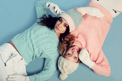 Beautiful young girls wear cozy warm knitted clothes Stock Photos
