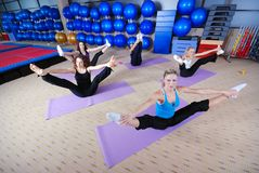 Beautiful young girls working out in a gym Stock Photo
