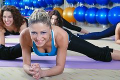 Beautiful young girls working out in a gym Royalty Free Stock Photo