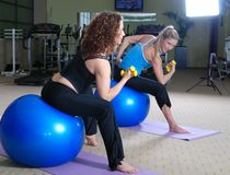 Beautiful young girls working out in a gym Royalty Free Stock Photography
