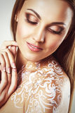 Beautiful young glamour woman with fantasy flower body art. Royalty Free Stock Photo