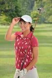 Beautiful Young Golfer Saluting Royalty Free Stock Photo