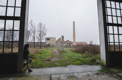 Beautiful young goth girl standing in abandoned factory building Stock Photos