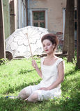 Beautiful young gothic girl in white shirt with umbrella Royalty Free Stock Image